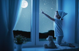 child-little-girl-at-window-dreaming-and-admiring-starry-sky-at-night-child-little-girl-at-the-stock-photos_csp36060931.jpg